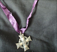 """The Memorial Cross (more often referred to as the Silver Cross) was first instituted by Order-in-Council 2374, dated December 1, 1919. It was awarded to mothers and widows (next of kin) of Canadian soldiers who died on active duty or whose death was consequently attributed to such duty. The crosses were sent automatically to mothers and wives who qualified, and could be worn by the recipients anytime, even though they were not themselves veterans. The cross was engraved with the name, rank and service number of the son or husband."" Veterans Affairs Canada"