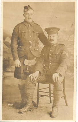 Private Moore (seated) with Private Lloyd S. Neff (standing).