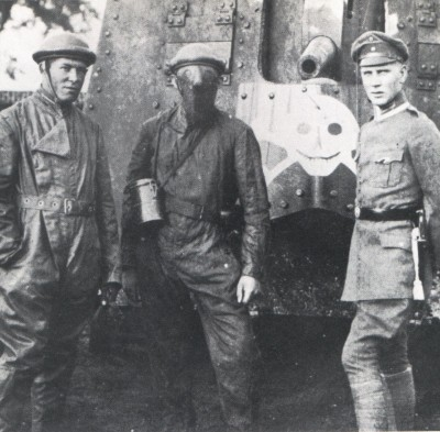 German tanker uniforms on left and center.