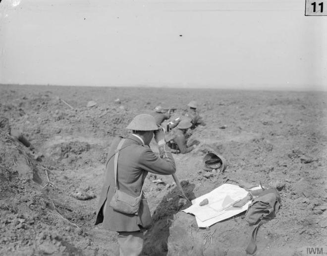 © IWM (Q 190) Battle of Flers-Courcelette. Officers observing from an old German front line trench, 15th September 1916.