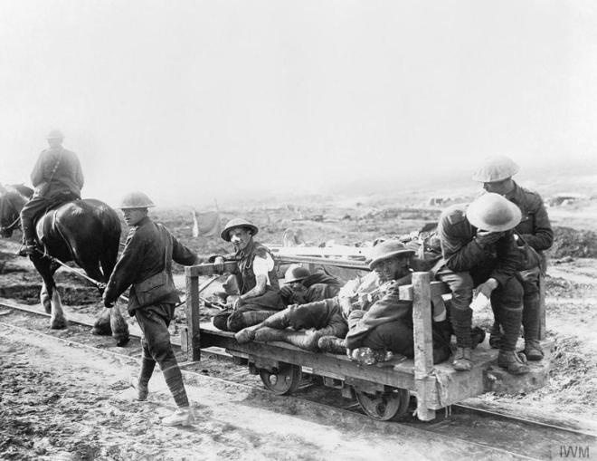 © IWM (CO 811) The Battle of Flers Courcelette 15 - 22 September: Canadian wounded being taken to a Dressing Station on a horse-drawn light railway.