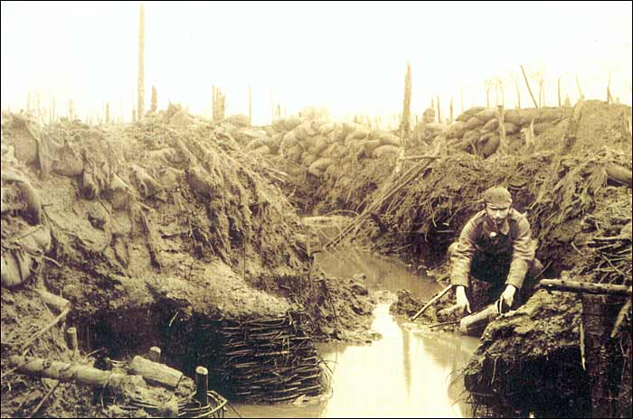 German soldier in a waterfilled trench in the vicinity of Ypres, Flanders (Belgium). This picture was made in November 1915. Source: http://lost-in-the-trenches.tumblr.com/page/3