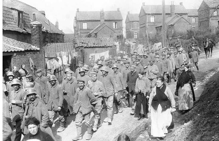 German captured by Canadians at Vimy Ridge passing through a French Village in 1917. Canada. Dept. of National Defence, Library and Archvies Canada.