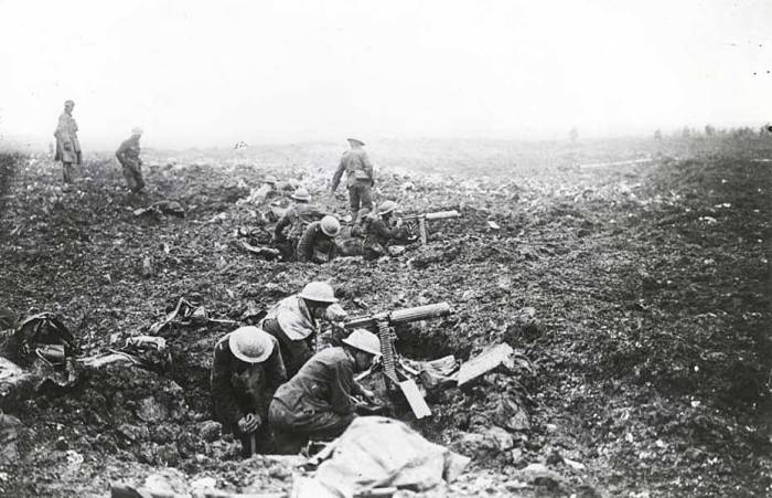 Squads of Canadian machine gunners operate from shell-craters in support of the infantry on the plateau above Vimy Ridge. Canada. Dept. of National Defence, Library and Archives Canada