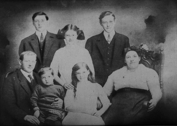 Family Photo – Fred Binns Family Portrait- Pre 1915 Father Alfred front left. Brother Rennie on father's knee. Mother Caroline front right. Sister Betty front middle. Brother Arthur back left. Sister Nellie back middle. Fred Binns back right. Source: CVWM