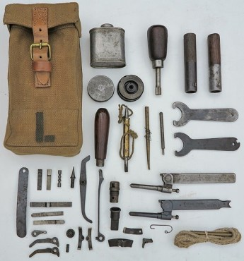 """""""A circa WWII modified 'L' marked pattern 37 web equipment Bren gun pouch with spare pawls, return springs, replacement parts, loading tools (metal and half metal/wood types), barrel spanners first and second type (modified from October 17th 1921-LOC 24676), clearing plugs MkI and MkII (from August 31st 1916-LOC 17938), gas regulator reamer, and bolt handle extension (an American product that fitted in to the bolt handle to assist with retracting a jammed bolt)."""" Source: http://gunshows.co.nz/wordpress/165/"""
