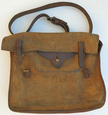 """A sample of a First World War era Lewis Gun parts bag. """"Bag, Spare Parts and Tools, MG., Mk III (November 15th 1918-LOC 18200). This 1918 dated 13×9 inch gusseted canvas and leather bag was issued for use with the Lewis and Hotchkiss. On the inside back of the bag are 3 pockets for (from left to right) oilcan, cleaning materials and tin box containing small parts. – Author."""" Source: http://gunshows.co.nz/wordpress/165/"""