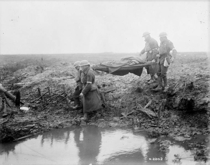 Wounded Canadians on way to aid-post. Battle of Passchendaele. November, 1917.