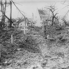 CASUALTIES OF THE WESTERN FRONT, 1914-1918. (Q 501) Shell crater in the graveyard outside the Lille Gate, Ypres, 30th March 1916. Photograph features identified graves of Captain William Sproat Montgomery, 'D' Company, 6th Battalion, The King's Regiment (Liverpool Regiment), and Private Robert Forster or Foster, 1st Battalion, Northumberland Fusiliers, service number 8878. Copyright: © IWM. Original Source: http://www.iwm.org.uk/collections/item/object/205077555