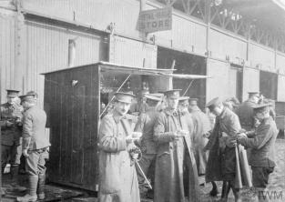 THE BRITISH EXPEDITIONARY FORCE ON THE WESTERN FRONT, 1914-1915 (Q 60500) Captain H.D. Lane, Medical Officer of the 1/6th Battalion, South Staffordshire Regiment, and troops of various units at a coffee stall outside Le Havre station, 1915. Copyright: © IWM. Original Source: http://www.iwm.org.uk/collections/item/object/205308062